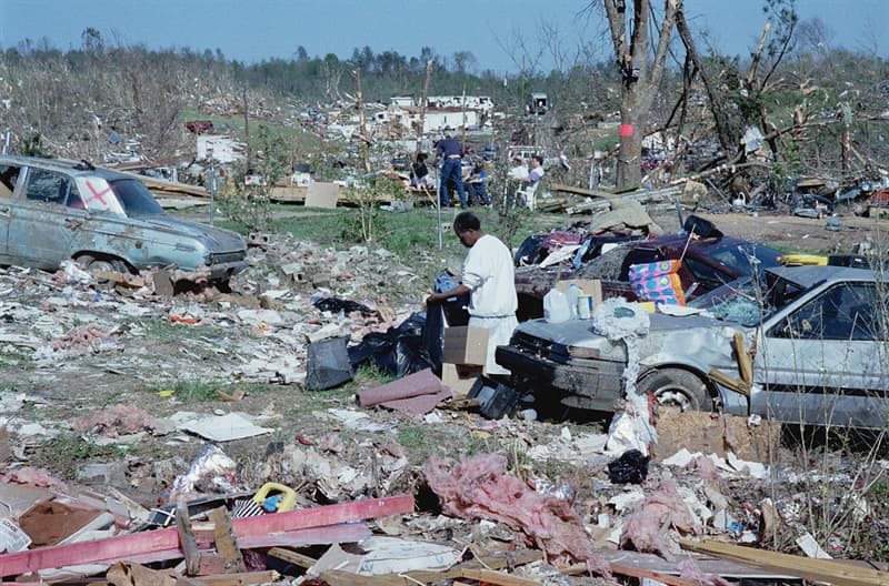 History Story: #4 Victims salvage possessions after tornado in Alabama, 1998