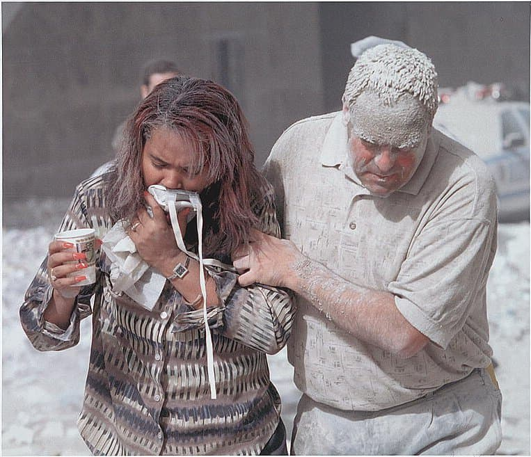 History Story: #8 Two survivors of 9/11 attacks are covered in dust after the collapse of the towers