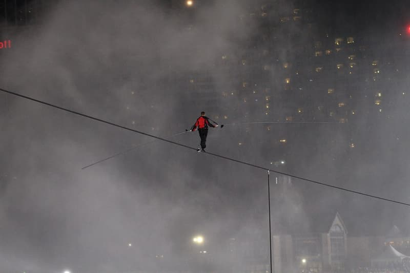Society Story: #3 A famous acrobat and high wire artist, Nik Wallenda, is crossing a wire amongst the mist of Niagara Falls