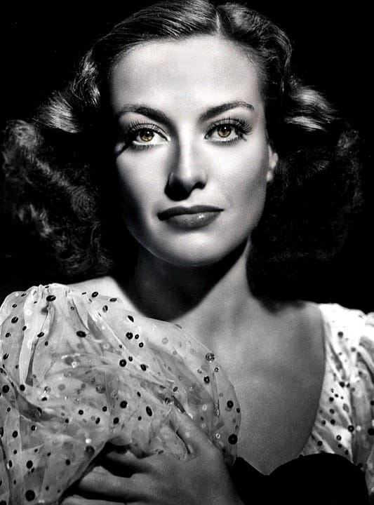 Movies & TV Story: Through many years the war continued until the death of Joan Crawford.