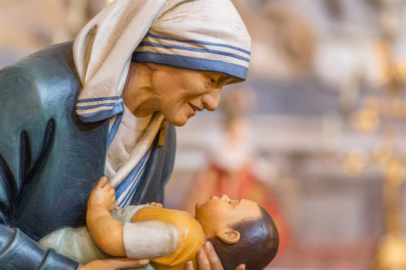 Society Story: #3 Blissful mother Teresa holding a child