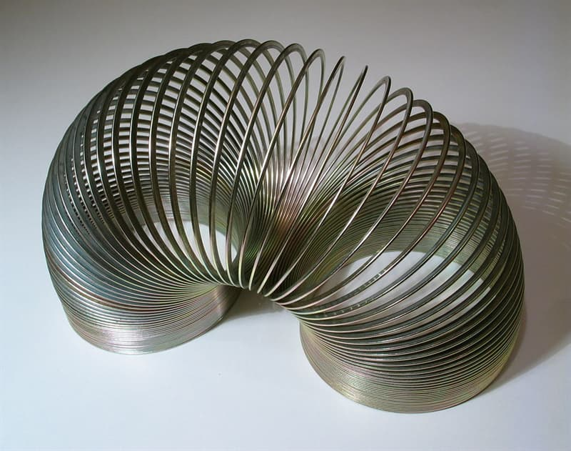 History Story: #9 THE SLINKY was developed as a spring that could keep sensitive equipment on ships steady at sea, but after accidentally knocking it off a shelf, Richard James and his wife developed it into a new toy