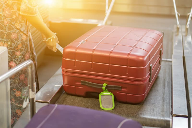 Society Story: #3 Take a photo of your checked luggage and put a colorful ribbon on it
