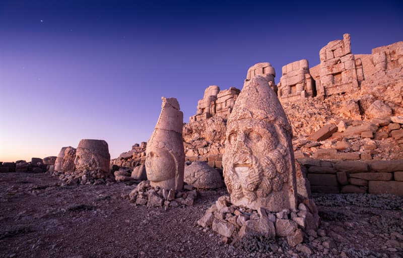 Culture Story: #8 The heads of the statues on the top of the Nemrut Mountain in Turkey. The statues are believed to be beheaded as a result of iconoclasm.