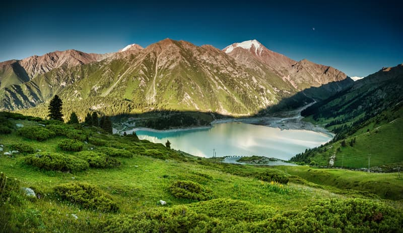 Geography Story: best places to visit if you are an introvert travel destinations Big Almaty Lake Kazakhstan
