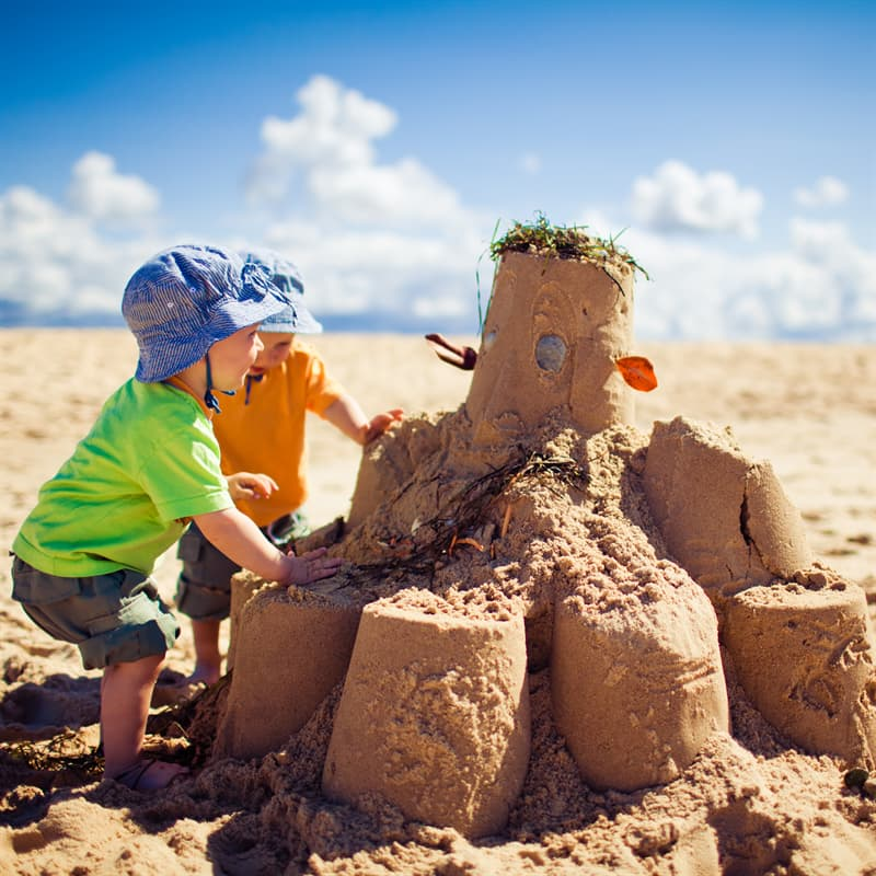 Society Story: best childhood memories building a sand castle
