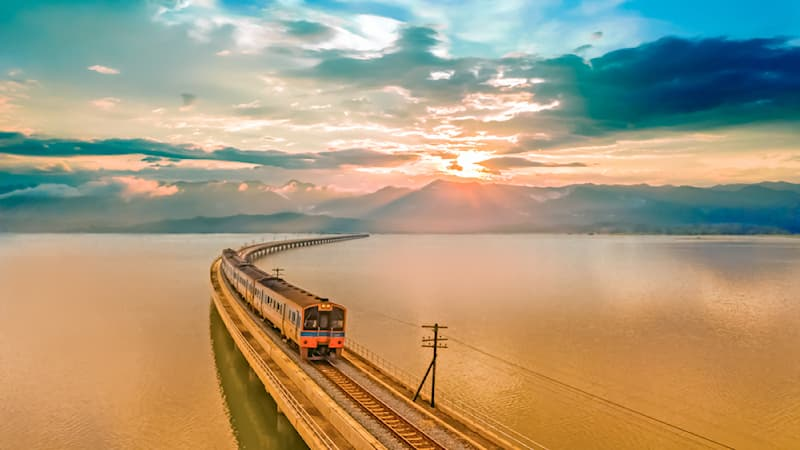 Geography Story: #4 The passenger tourists train above the Pa Sak Jolasid lake in Thailand taken at sunset.