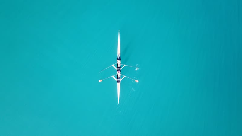 Geography Story: #6 Two women in a sport canoe shot from above by a drone.