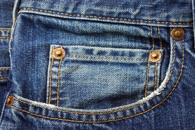 Culture Trivia Question: A traditional pair of jeans has a tiny pocket just above the front pocket. What was originally supposed to be kept in the tiny pocket?
