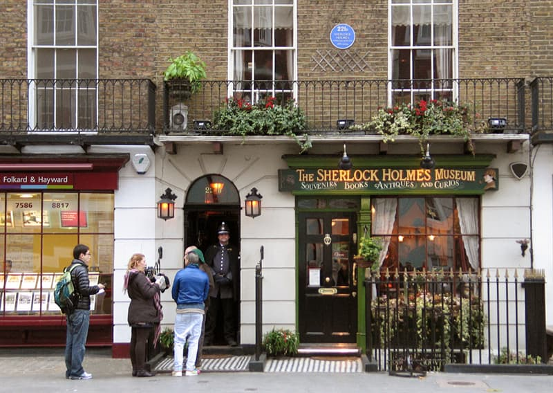 Geography Trivia Question: 221b Baker St, London has become a world-famous address. What are the numbers of the adjoining premises?