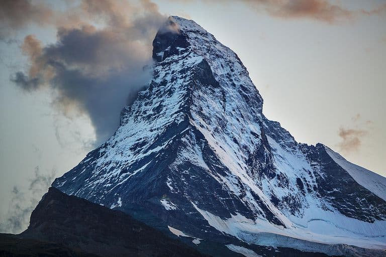 Geography Trivia Question: The peak of one of these mountains is the point on the earth's surface which is furthest from earth's centre. Which one?