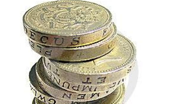 Society Trivia Question: There are eight different coins used in the UK today: how many of them are heptagonal?