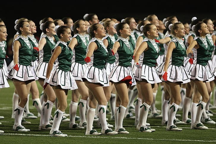 Sport Trivia Question: What National Football League (NFL) team was the first to have cheerleaders?