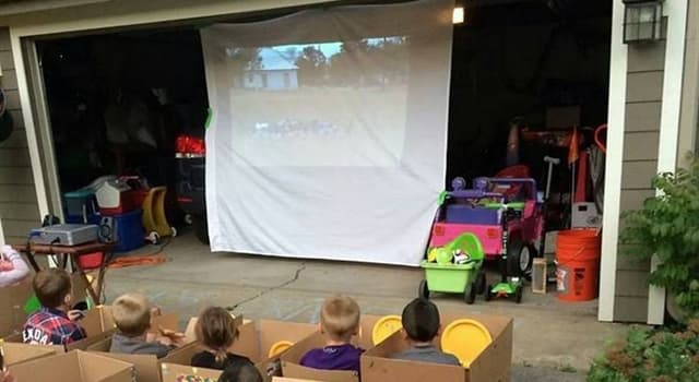 History Trivia Question: In the United States, which year did motorists first enjoy a movie at an outdoor, drive-in theater?
