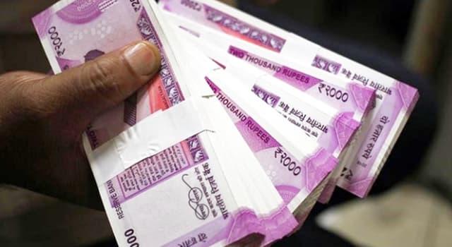 społeczeństwo Pytanie-Ciekawostka: Czyja twarz pojawia się na większości indyjskich rupii?