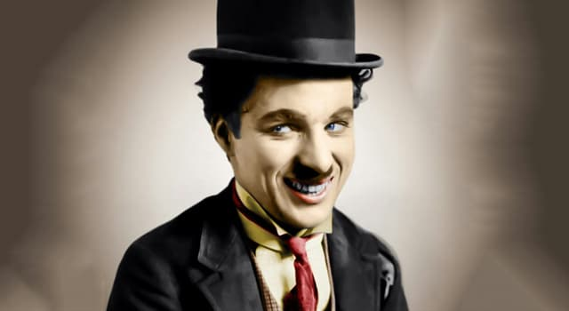 Society Trivia Question: In which year did Charlie Chaplin receive his knighthood from Queen Elizabeth II?