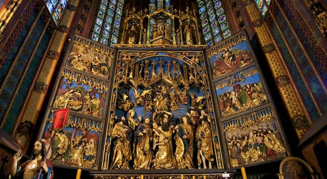 Geography Trivia Question: In which city will you find the largest Gothic altarpiece in the world?