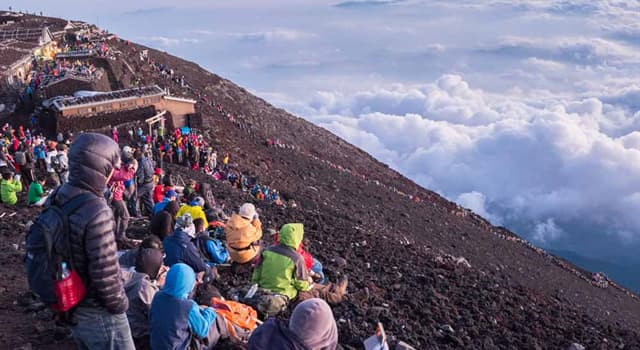 Culture Trivia Question: What is the end of the Japanese proverb - 'He who climbs Mount Fuji is a wise man, he who climbs twice is a'?