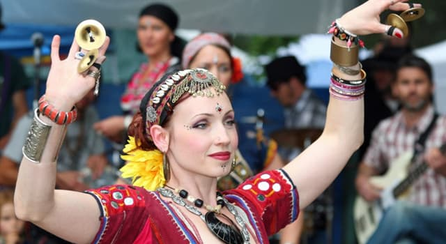 Culture Trivia Question: What is this dancer holding in her hands?