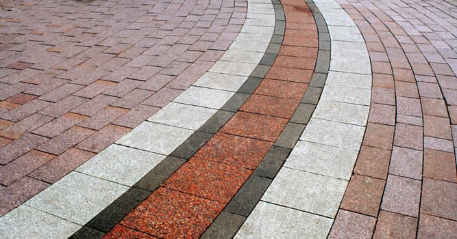 Society Trivia Question: What is a broadly rectangular quarried stone used in paving roads called?