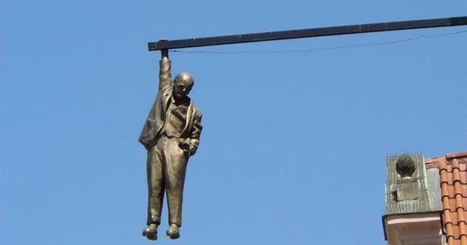 Culture Trivia Question: In which European city will you see the 'Man Hanging Out' sculpture?