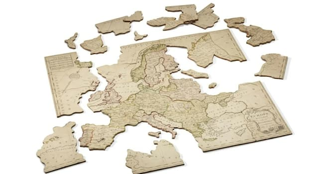 History Trivia Question: What were the first jigsaw puzzles made of?