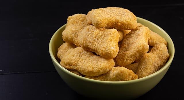 Общество Вопрос: Как называется блюдо американской кухни из филе куриной грудки в хрустящей панировке, обжаренной в масле?