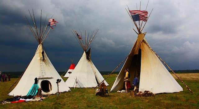 Общество Вопрос: Как называется территория в США, Канаде и Южной Америке, управляемая индейским племенем?