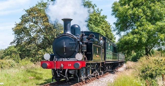 History Trivia Question: Now disused, Wolferton railway station was once used by the British Royal Family to travel to which residence?
