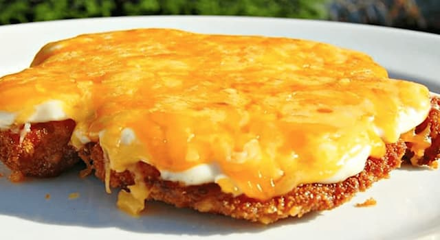 Culture Trivia Question: The parmo is a dish made from breaded meat and cheese sauce that originated in which English town?