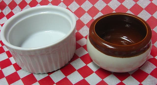 Culture Trivia Question: What is the name of the small round baking dishes shown in the picture?