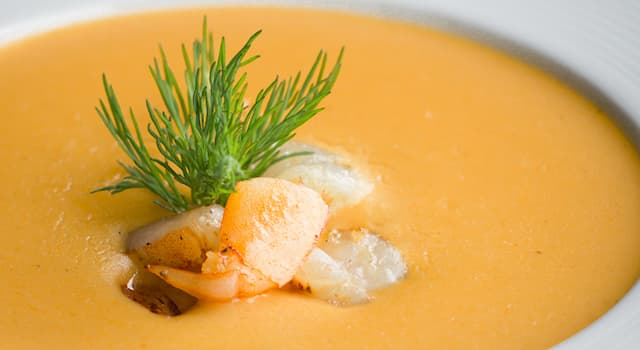 Culture Trivia Question: What is the name of the smooth creamy seafood soup in the picture?
