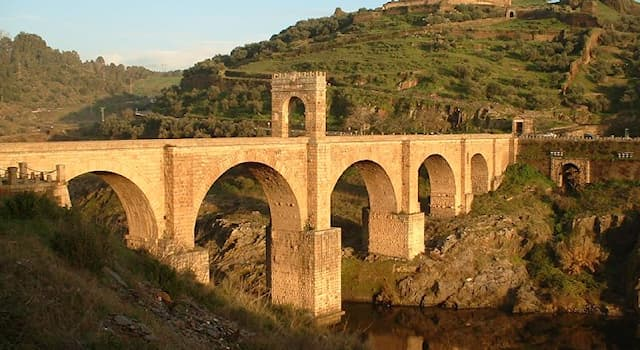 Geography Trivia Question: Which river does the Roman stone bridge of Alcantara cross?