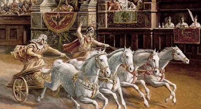 History Trivia Question: What Latin term refers to a two wheeled car, drawn by fourhorsesin chariot racinginclassical antiquity?